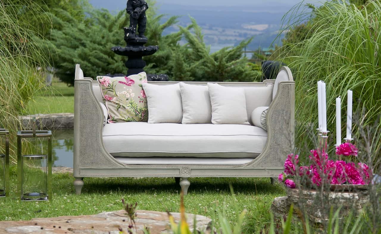 Six of Top Tips to Make Your Backyard and Patio Useable All Year Round: Sofa in a Home Garden