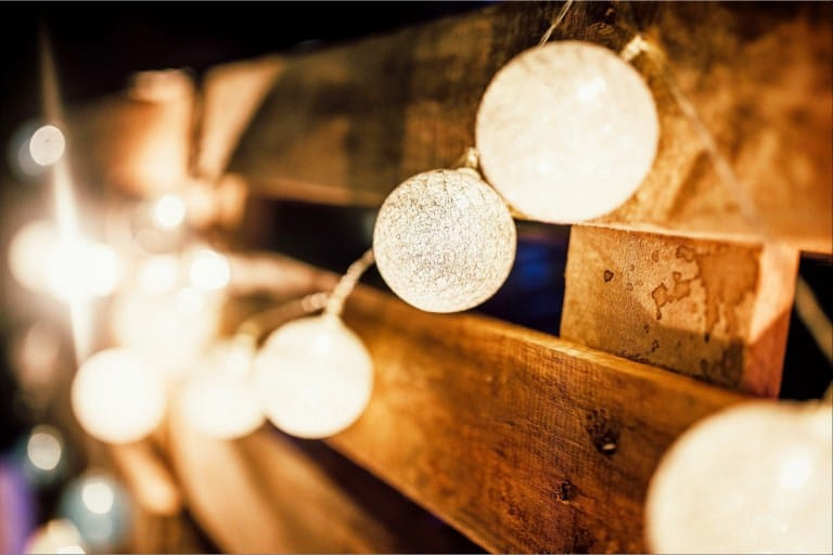 Six of Top Tips to Make Your Backyard and Patio Useable All Year Round: Light Bulb Hanging on A wooden wall