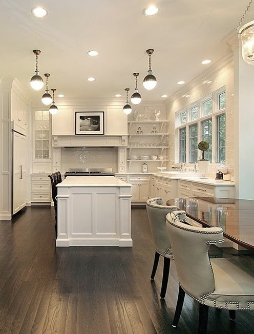 How far apart should pendant lights be over an island in the kitchen: White kitchen with 6 pendant lights