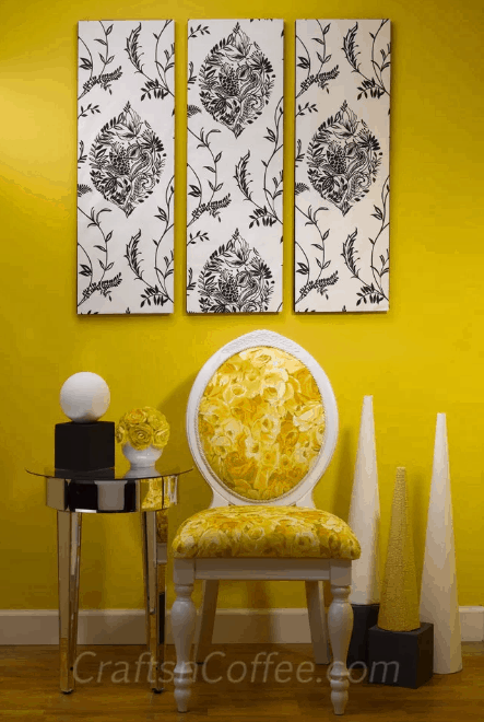 Yellow wall with 3 wall art made with wall paper