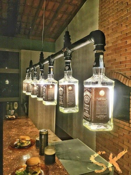 Track lights made of recycled Jack Daniels wiskey bottles #upcycling #wiskey #bottle #ropeLights #lighting #lights #homeDecor #interiorDesign