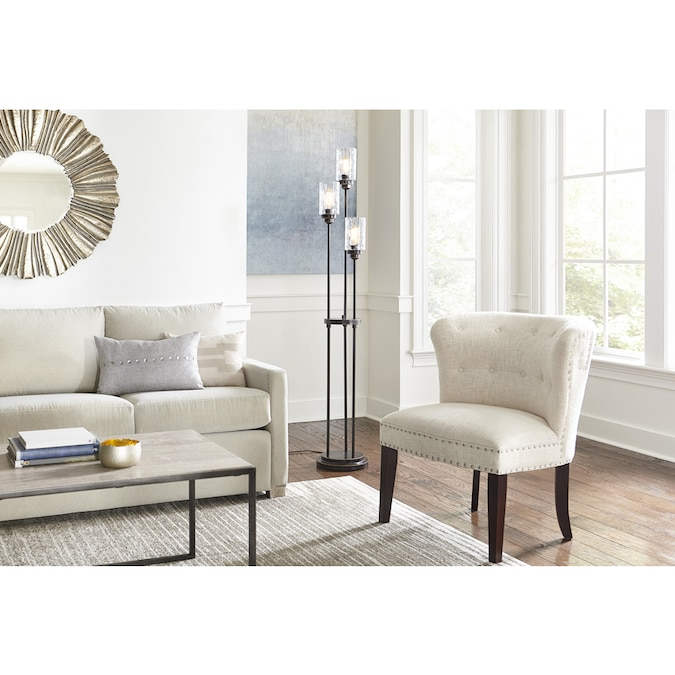 A gorgeous floor lamp in the middle of the living room